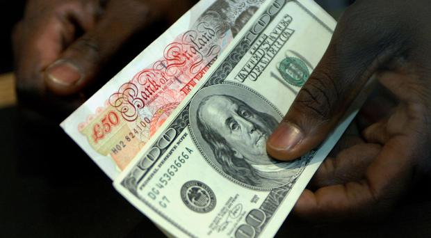 Sterling lost ground against the dollar