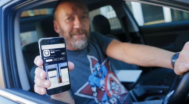 An Uber driver from Belfast at the company's launch here in December