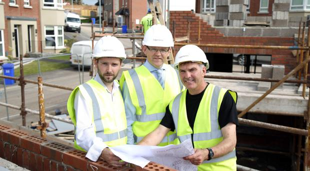 Michael McCormick, contracts manager, Conor Mulligan, managing director, and Johnston Logan, site manager of Lagan Homes