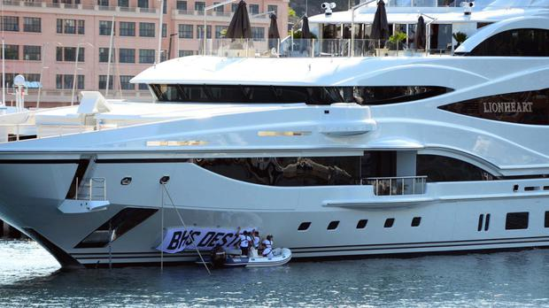 Sir Philip Green's super yacht has been attacked by comedians and protesters.