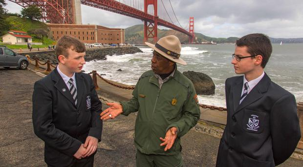 Last year's Digital Future winners Liam Broadway and Sam Stuart, pupils at Dominican College, Portstewart with park ranger Rik Penn at the Golden Gate Bridge in San Francisco