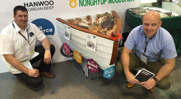 Steven Pryce of Sea Source and Shane McArdle from Invest NI highlight our best fish in Hong Kong
