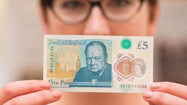 The note features Sir Winston Churchill