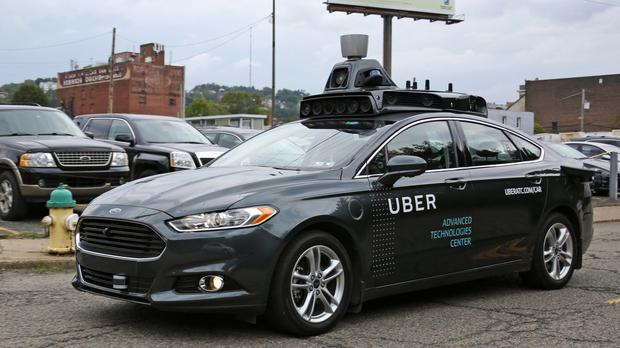 A self-driving Uber car drives down River Road on Pittsburgh's Northside (AP)