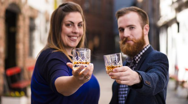 Whiskey ambassador Joe McGowan with Sarah Harvey, Powers brand manager at Dillon Bass