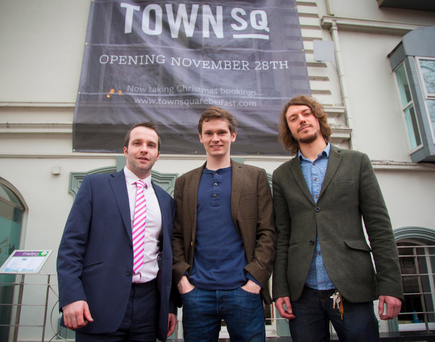 Liam McAuley, Peter Ringland and Nathan Reid outside Town Square restaurant in Belfast