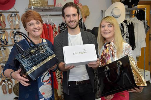 Grainne McVeigh, director of consumer products with Invest NI, pictured with Blayne Shaw and Kirsty Roy of Pia Rossini — the children of the fashion company's founders