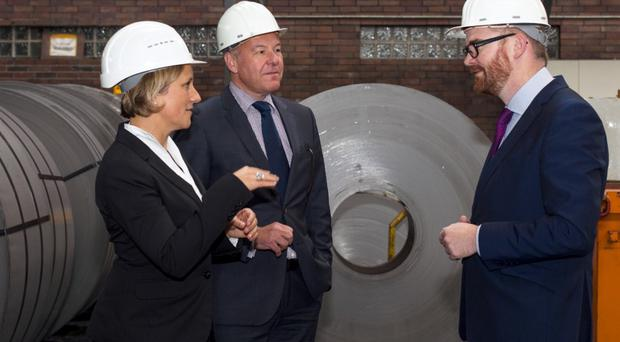 Economy Minister Simon Hamilton visiting Wickeder Westfalen Stahl. He is joined by chief operating officer Andreas Braun and Carina Franken