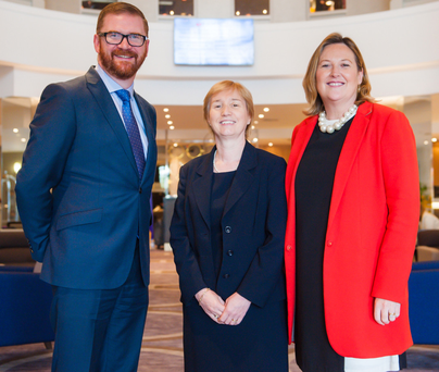 From left, Economy Minister Simon Hamilton with Regina Moran, head of industry sectors business application services Fujitsu EMEIA, and Women in Business chief executive Roseann Kelly