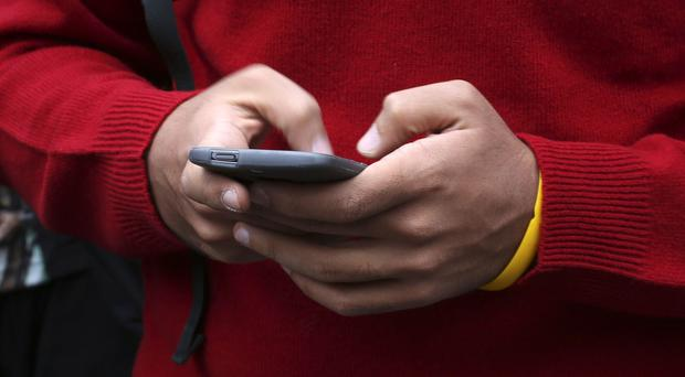 Checking out comparison websites on smartphone