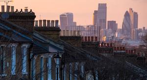 Houses in south London and the skyline of the City financial district
