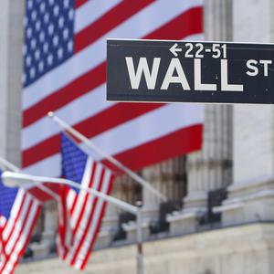 The Dow Jones industrial average jumped 164.70 points to 18,308.15 on Friday