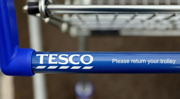 Tesco suspended eight directors