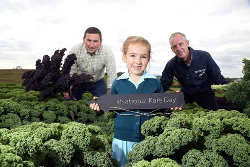 Peter Robinson, procurement manager at the North Down Group, with farmer James Booth of Windwhistle Farm and his four-year-old daughter Rachel Booth