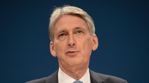 Chancellor Philip Hammond said he approved of a fresh round of QE in August