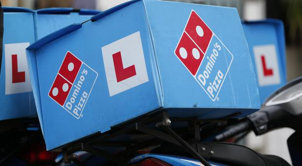 Domino's Pizza said its investment in digital platforms and new store openings helped boost turnover