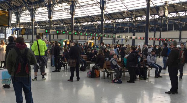Passengers on the concourse at Brighton Railway Station.