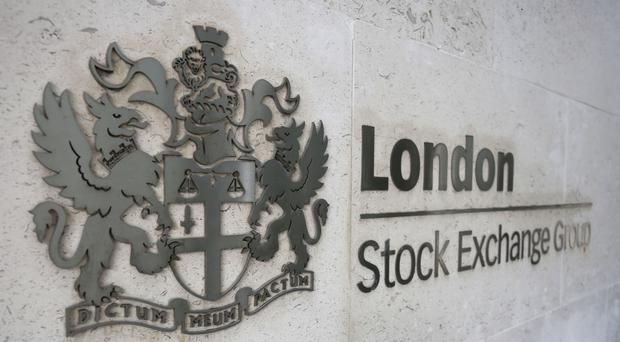 The FTSE 100 Index was rooted in the red, down 46.66 points to 6,977.36
