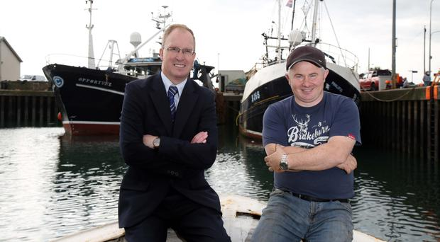 Keith Thompson (left) of Ulster Bank and William Coffey in Portavogie with The Opportune