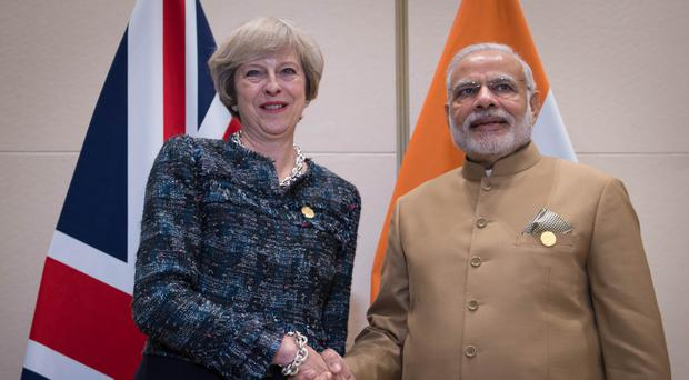 Theresa May will meet Narendra Modi on her trip
