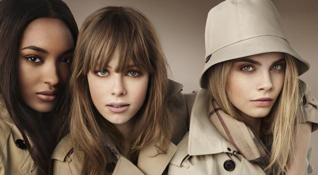 Models Malaika Firth, Suki Waterhouse and Cara Delevingne wearing Burberry