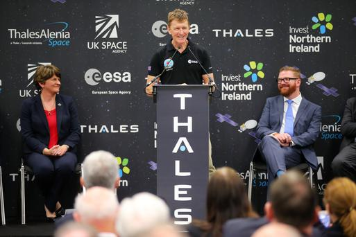First Minister Arlene Foster and Economy Minister Simon Hamilton look on as Tim Peake officially opens the new Thales space propulsion centre in Belfast