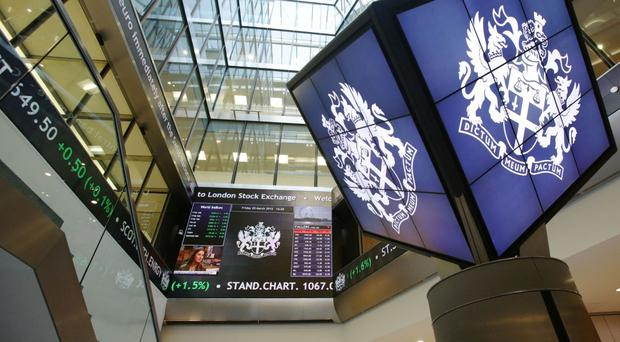 File photo dated 20/3/2015 of an information screen displaying the FTSE 100 at the London Stock Exchange, as the owner of the New York Stock Exchange, the Intercontinental Exchange (ICE), has said that it will not pursue a takeover of the London Stock Exchange (LSE).