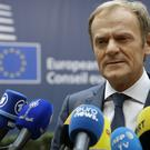 Donald Tusk speaks to reporters as he arrives for the EU summit in Brussels (AP)