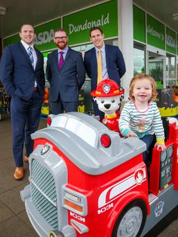 Economy Minister Simon Hamilton with Brian McAreavey, Clearhill commercial director, John McAreavey, the firm's financial director, and Mia Conlan, trying out of the company's rides