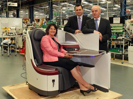 From left, First Minister Arlene Foster, general manager Neil Cairns and director of furnishing and fittings Francis Kelly during a tour of B/E Aerospace
