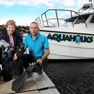 Richard Lafferty, owner of Portstewart-based Aquaholics, with Rhonda McClelland of Ulster Bank with the company's new boat, moored at Ballycastle