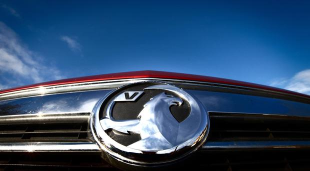 The Vauxhall cars owner has suffered a 100 million US dollars (£82.4 million) blow from the slump in sterling