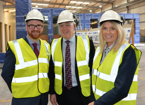 From left, Economy Minister Simon Hamilton with McAvoy managing director Eugene Lynch and executive chairperson Orla Corr