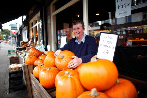 Ivan McElroy, owner of McElroy's Fruit & Veg in Ballyhackamore, east Belfast, with some of the hundreds of pumpkins on sale at his shop