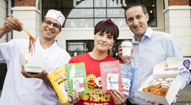 From left, Bobby Iacob of Chopstix, Julie Donley from The Works and Michael McAllister of Greggs mark the launch of their stores at Fairhill