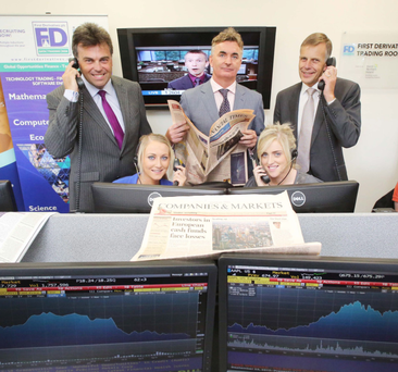 In the trading room at Queen's University Management School are (left to right) Alastair Hamilton, CEO Invest Northern Ireland; Nichorra McKenna, QUB student from Tyrone; Brian Conlon, CEO of First Derivatives plc; Janine McNeill, QUB student from Magherafelt; and Queen's University President and Vice-Chancellor Professor Sir Peter Gregson