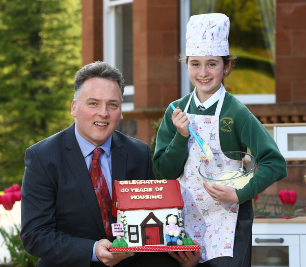 Fold Housing celebrated its 40th anniversary this year. Chief executive John McLean joined Shauna McRandal from St Patrick's Primary School in Holywood to put the finishing touches to its anniversary cake