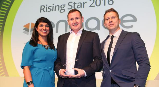 From left, Sonia Armstrong of Ulster Business magazine presents the rising star award to Steven Cassin and Stephen Leathem of Engage