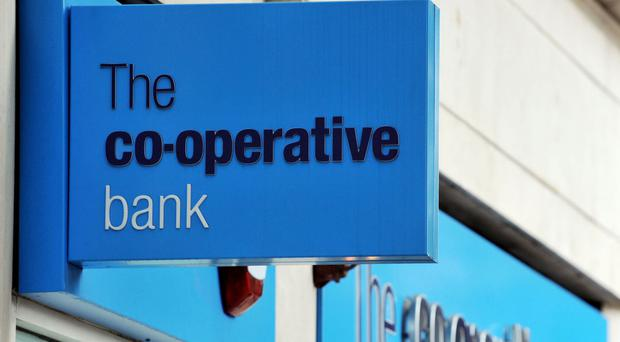 The Co-operative Bank has returned to profit but low interest rates could hit its turnaround plan