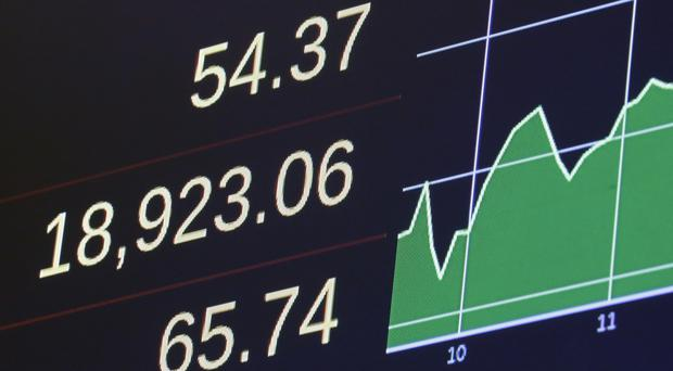 The closing number for the Dow Jones industrial average as energy companies led the stock market higher (AP)