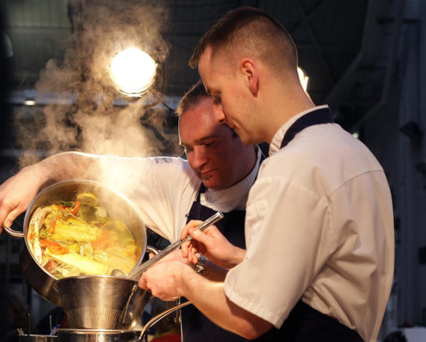 Niall McKenna and Stephen Toman cooking in St George's Market