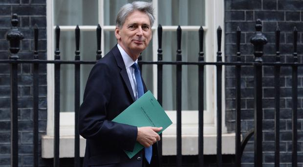 Philip Hammond said he would publish a draft Charter for Budget Responsibility demanding the public finances are back in the black 'as early as possible' in the next Parliament