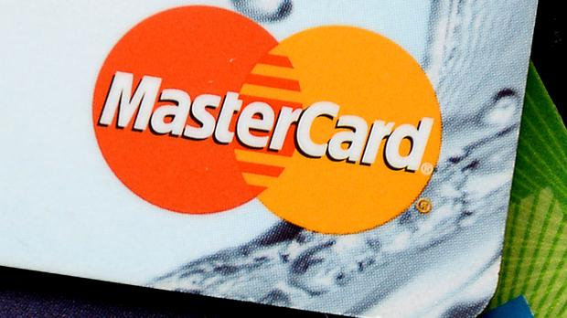 A damages claim has been filed against MasterCard over card charges that were passed on to shoppers
