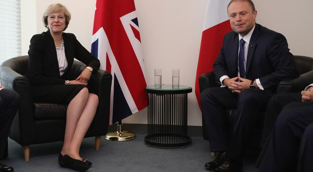 The prime minister of Malta, Joseph Muscat, pictured with Theresa May (File photo)