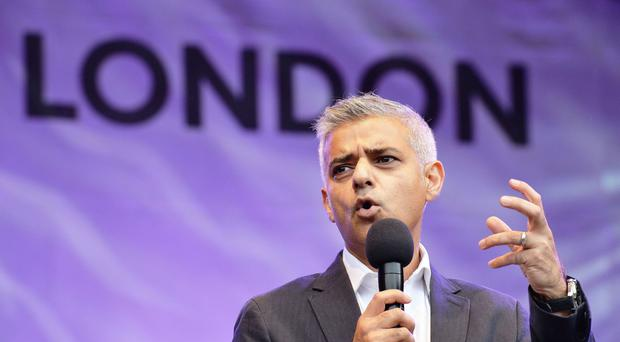 Sadiq Khan is to host a business summit to consider proposals for special work permits to allow EU nationals to take jobs in London