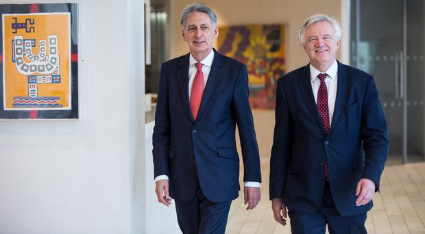 Chancellor Philip Hammond and the Secretary of State for Exiting the European Union David Davis arrive for a meeting with executives from the financial services at the Shard in central London