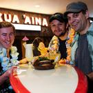 Kua 'Aina Belfast general manager Ciaran Sloan (left), operations director Patrick Gray and co-founder Ed Bardos celebrate the restaurant's first year in Belfast's Victoria Square
