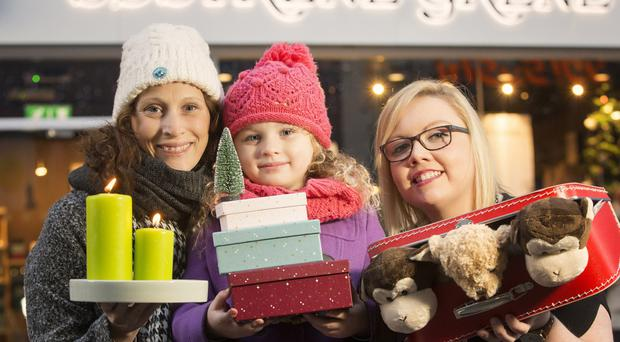 Kat Cassidy (left) with her daughter Ava and store manager Nuala McNally