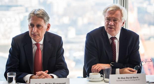 Chancellor Philip Hammond and Brexit Secretary David Davis during a meeting with executives from the financial services at the Shard in central London