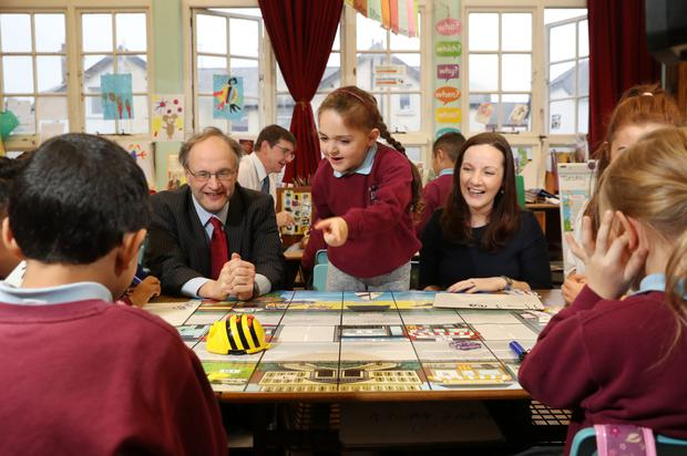 From left, Education Minister Peter Weir, who went to Fane Street Primary School to launch the Barefoot Computing Programme with the help of P2 pupil Nicole Chrapkowski and Mairead Meyer, managing director of networks at BT in Northern Ireland